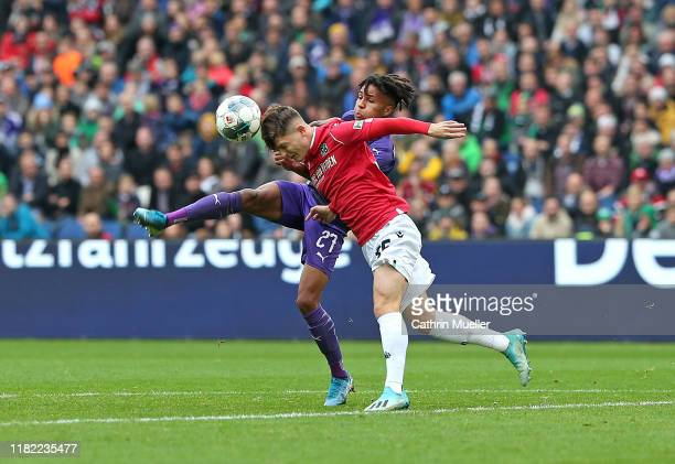 Felix Agu of VfL Osnabrueck and Florent Muslija of Hannover 96 battle for the ball during the Second Bundesliga match between Hannover 96 and VfL...