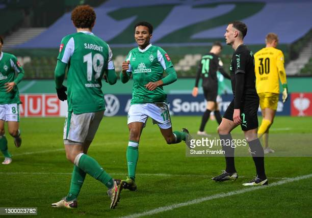 Felix Agu of Werder Bremen celebrates after scoring their side's second goal during the DFB Cup Round of Sixteen match between Werder Bremen and...