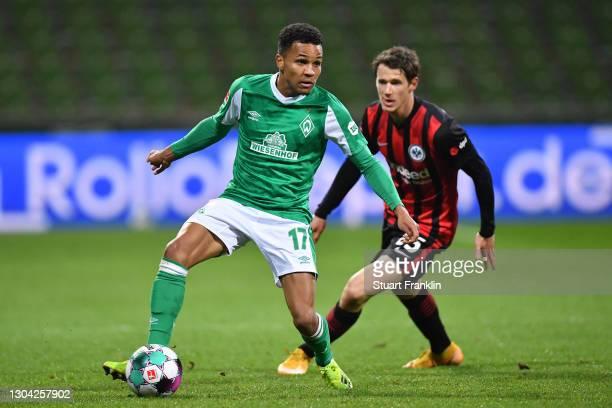 Felix Agu of Werder Bremen is challenged by Eric Durm of Eintracht Frankfurt during the Bundesliga match between SV Werder Bremen and Eintracht...
