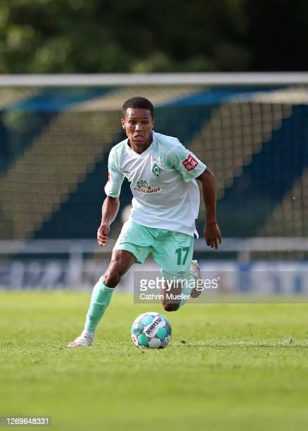 Felix Agu of Werder Bremen runs with the ball during the pre-season friendly match between SV Werder Bremen and FC St. Pauli at Blau-Weiss Lohne...