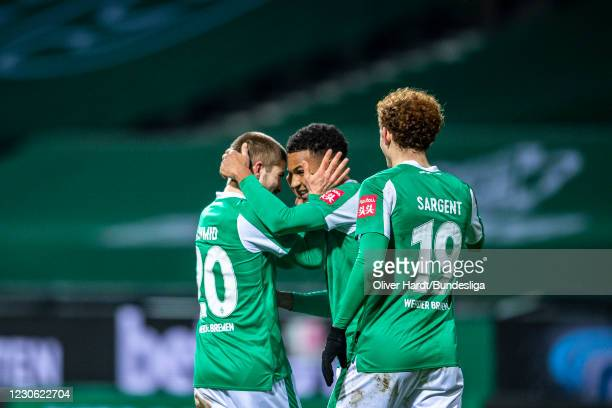 Felix Aguc of SV Werder Bremen celebrates with teammates after scoring his team's second goal during the Bundesliga match between SV Werder Bremen...