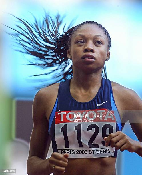 US Felix Allyson competes in the 200m 1st round 26 August 2003 during the 9th IAAF World Athletics Championships at the Stade de France in SaintDenis...
