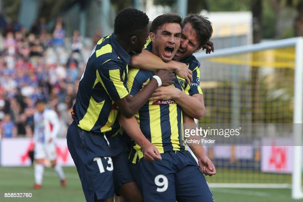 Felix Asdruval Padron Hernandez of the Mariners celebrates his goal with team mates during the round one A-League match between the Central Coast...