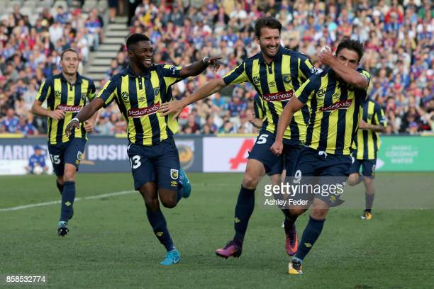 Felix Asdruval Padron Hernandez of the Mariners celebrates his goal with team mates during the round one ALeague match between the Central Coast...
