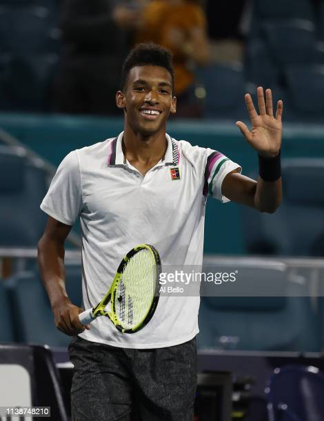 Felix Auger Aliassime of Canada celebrates match point against Borna Coric of Croatia during day 10 of the Miami Open presented by Itau at Hard Rock...