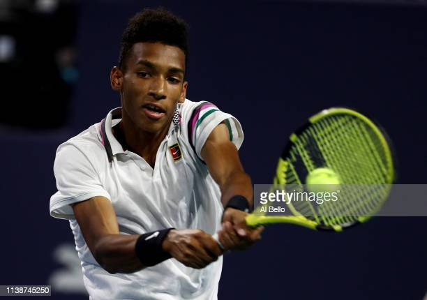 Felix Auger Aliassime of Canada plays a point against Borna Coric of Croatia during day 10 of the Miami Open presented by Itau at Hard Rock Stadium...