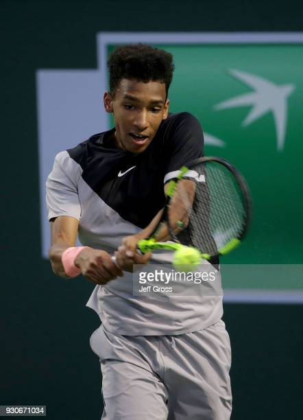 Felix Auger Aliassime of Canada returns a backhand to Milos Raonic of Canada during the BNP Paribas Open on March 11 2018 at the Indian Wells Tennis...