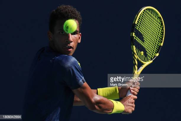Felix Auger Aliassime of Canada returns a shot during his men's singles second round match against Pierre-Hugues Herbert of France on Day 5 of the...