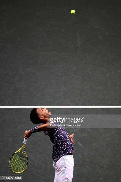 Felix Auger Aliassime of Canada serves against Aljaz Bedene of Slovenia during Day 7 of the ABN AMRO World Tennis Tournament at Rotterdam Ahoy on...
