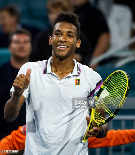 Felix AugerAliasseme of Canada celebrates after beating Borna Coric of Croatia in the quarterfinals of the men's singles at the Miami Open at the...