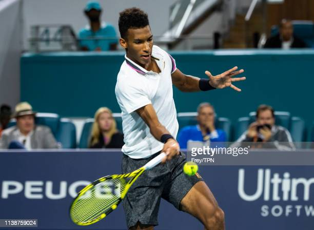 Felix AugerAliasseme of Canada chits a forehand against Borna Coric of Croatia in the quarterfinals of the men's singles at the Miami Open at the...