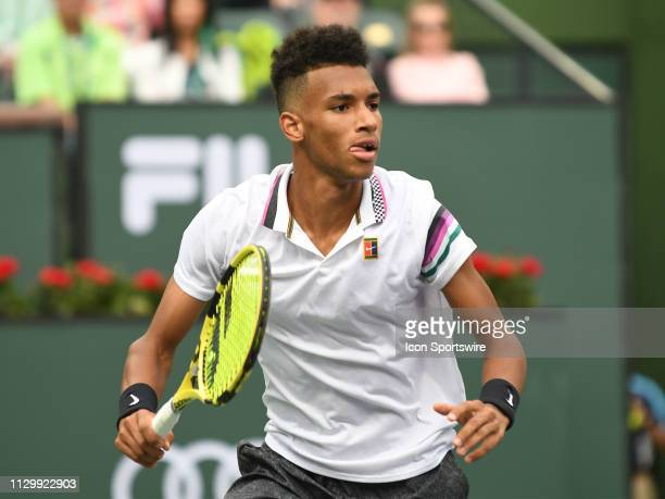 Felix AugerAliassime In action hitting a forehand during his 3rd round match at the BNP Paribas Open on March 11 at the Indian Wells Tennis Garden in...