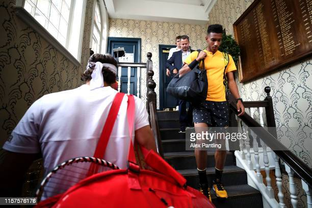 Felix AugerAliassime of Canada and Feliciano Lopez of Spain make their way out onto court ahead of their mens singles semifinal match during day six...