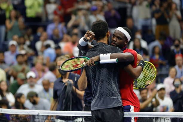 Felix Auger-Aliassime of Canada and Frances Tiafoe of the United States meet at center court after Auger-Aliassime won during their Men's Singles...