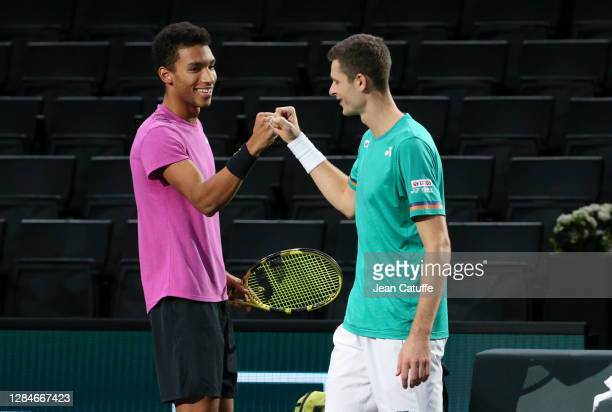 Felix Auger-Aliassime of Canada and Hubert Hurkacz of Poland celebrate their victory in the men's doubles final on day 7 of the Rolex Paris Masters,...