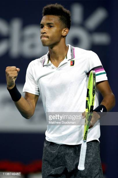 Felix AugerAliassime of Canada celebrates a point against Borna Coric of Croatia during the Miami Open Presented by Itau at Hard Rock Stadium March...