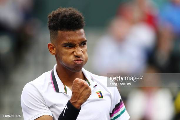 Felix AugerAliassime of Canada celebrates a point against Yoshihito Nishioka of Japan during their men's singles third round match on Day 8 of the...