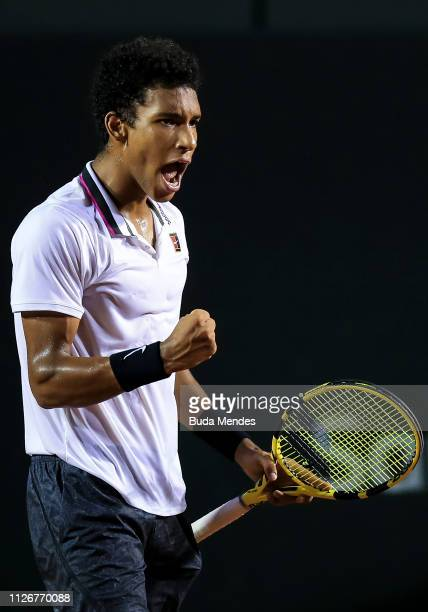 Felix AugerAliassime of Canada celebrates a point during a match against Jaume Munar of Spain during the ATP Rio Open 2019 at Jockey Club Brasileiro...