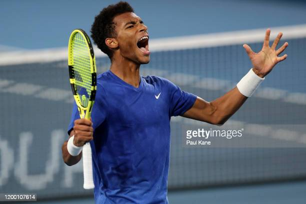 Felix Auger-Aliassime of Canada celebrates a point in the second set tie break of the semi final match against Andrey Rublev of Russia during day six...