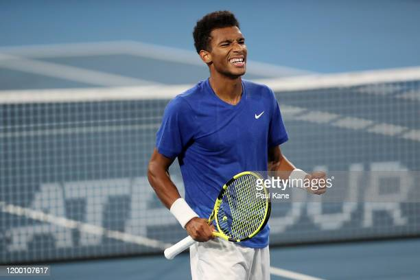 Felix AugerAliassime of Canada celebrates a point in the second set tie break of the semi final match against Andrey Rublev of Russia during day six...