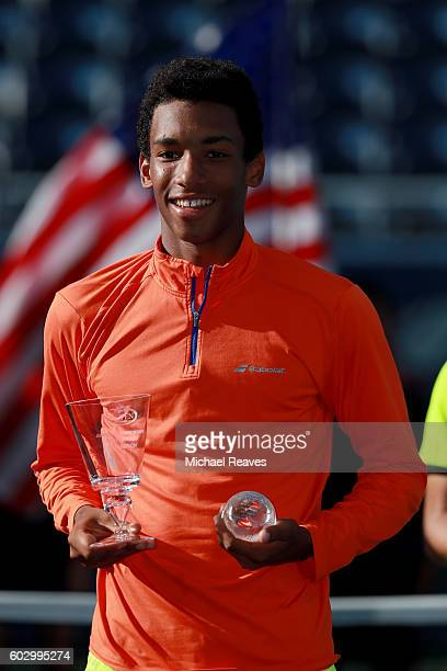Felix AugerAliassime of Canada celebrates after defeating Miomir Kecmanovic of Serbia in their Junior Boys' Singles Final Match on Day Fourteen of...