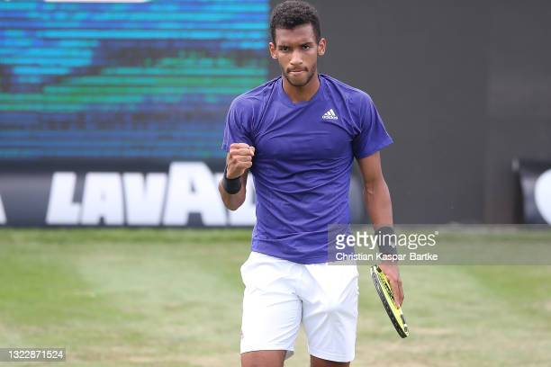 Felix Auger-Aliassime of Canada celebrates after winning his match against Lloyd Harris of South Africa during day 4 of the MercedesCup at Tennisclub...