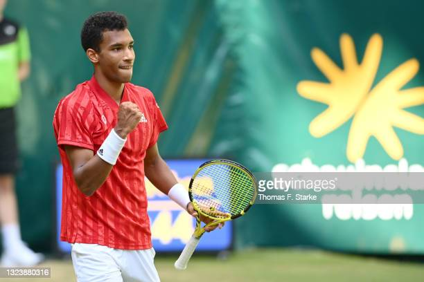 Felix Auger-Aliassime of Canada celebrates after winning his match against Roger Federer of Switzerland during day 5 of the Noventi Open at OWL-Arena...