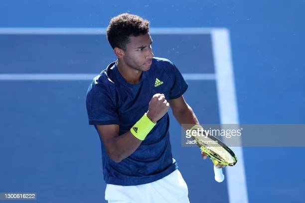 Felix Auger-Aliassime of Canada celebrates after winning match point in his Men's Singles semifinal match against Corentin Moutet of France during...