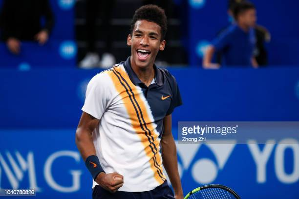 Felix AugerAliassime of Canada celebrates against Chung Hyeon of Korea during 2018 ATP World Tour Chengdu Open at Sichuan International Tennis Centre...