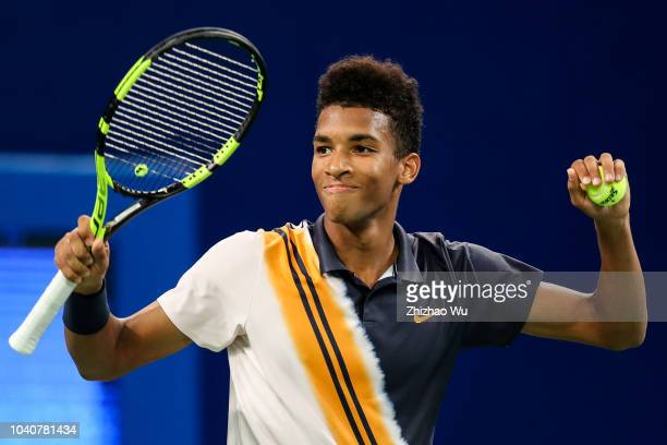 Felix AugerAliassime of Canada celebrates against Chung Hyeon of South Korea during ATP World Tour Chengdu Open 2nd Round at Sichuan International...