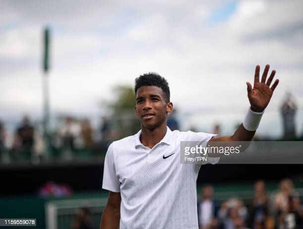 Felix AugerAliassime of Canada celebrates his victory over Vasek Pospisil of Canada during Day 1 of The Championships Wimbledon 2019 at All England...
