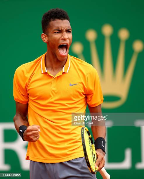 Felix AugerAliassime of Canada celebrates match point against Juan Ignacio Londero of Argentina in their first round match during day 3 of the Rolex...