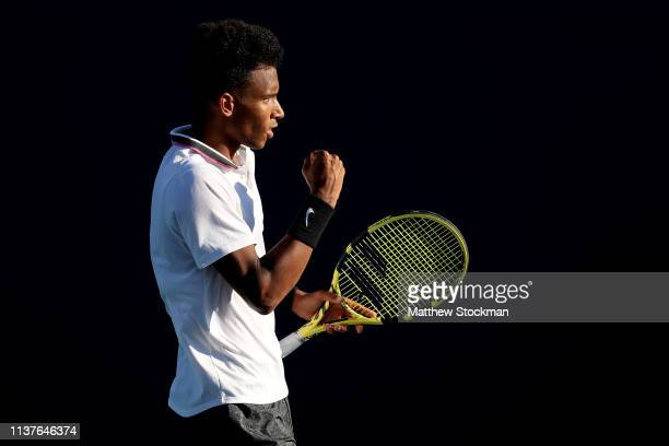 Felix AugerAliassime of Canada celebrates match point against Marton Fucsovics of Hungary during the Miami Open Presented by Itau at Hard Rock...