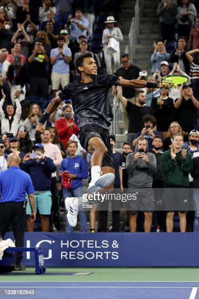 Felix Auger-Aliassime of Canada celebrates match point against Roberto Bautista Agut of Spain during his Men's Singles third round match on Day Five...