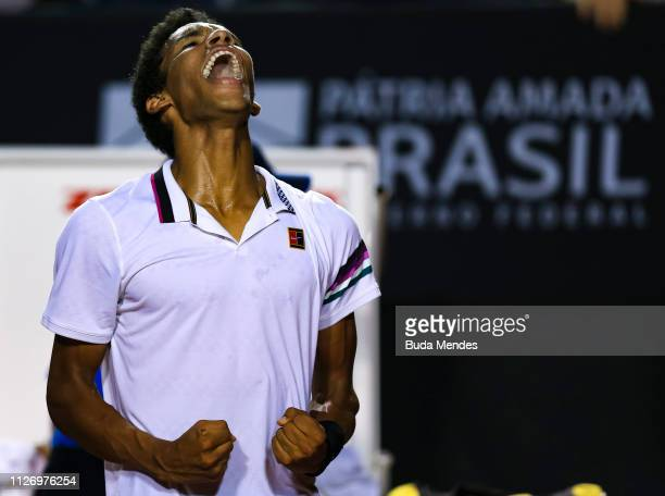 Felix AugerAliassime of Canada celebrates the victory against Pablo Cuevas of Uruguay during the singles semi final of the ATP Rio Open 2019 at...