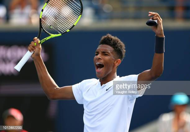 Felix AugerAliassime of Canada celebrates victory over Lucas Pouille of France following a 1st round match on Day 2 of the Rogers Cup at Aviva Centre...
