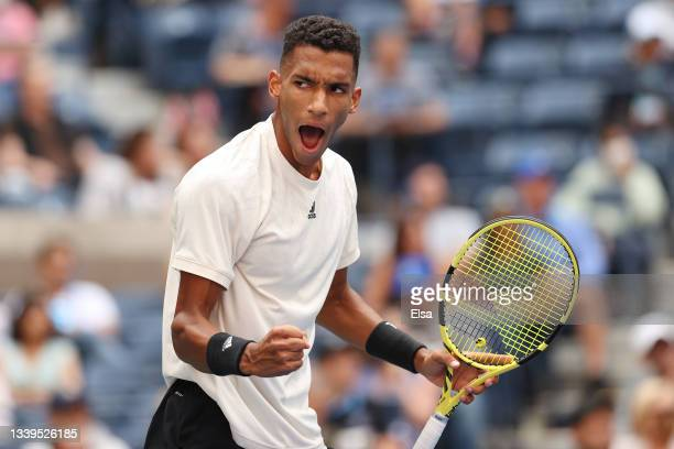 Felix Auger-Aliassime of Canada celebrates winning a game in the first set against Daniil Medvedev of Russia during their Men's Single semifinal...