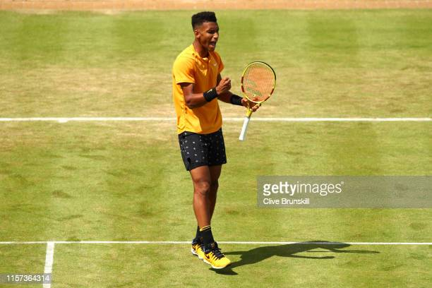 Felix AugerAliassime of Canada celebrates winning the first set during his QuarterFinal Singles Match against Stefanos Tsitsipas of Greece during day...