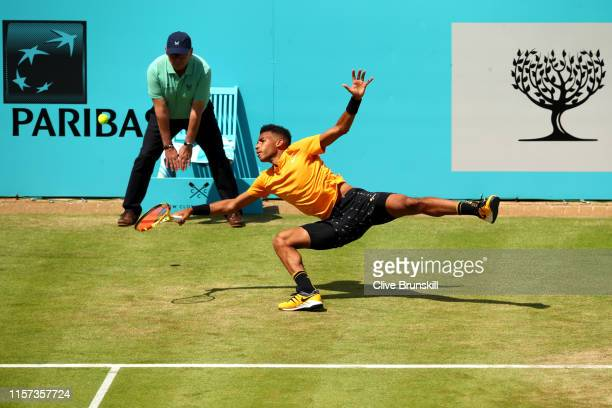 Felix AugerAliassime of Canada dives to play a forehand during his QuarterFinal Singles Match against Stefanos Tsitsipas of Greece during day Five of...