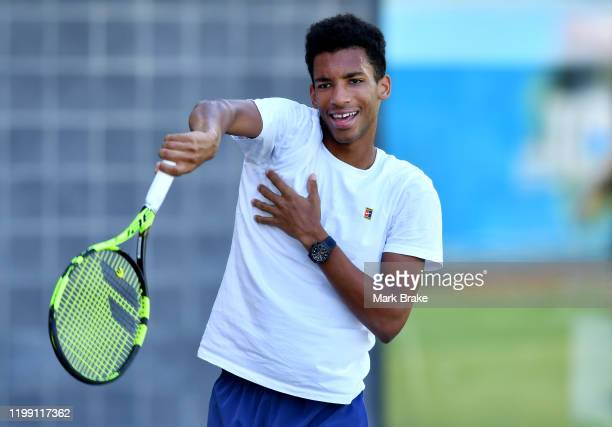 Felix AugerAliassime of Canada during his prewarm up before his training session on court 5 during day two of the 2020 Adelaide International at...