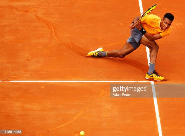 Felix AugerAliassime of Canada hits a backhand during his first round match agains Borna Coric of Croatia during day two of the International BNL...