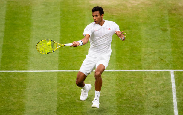 Felix Auger-Aliassime of Canada hits a forehand against Alexander Zverev of Germany in the fourth round of the gentlemen's singles during Day Seven...