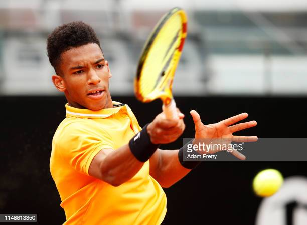 Felix AugerAliassime of Canada hits a forehand during his first round match agains Borna Coric of Croatia during day two of the International BNL...
