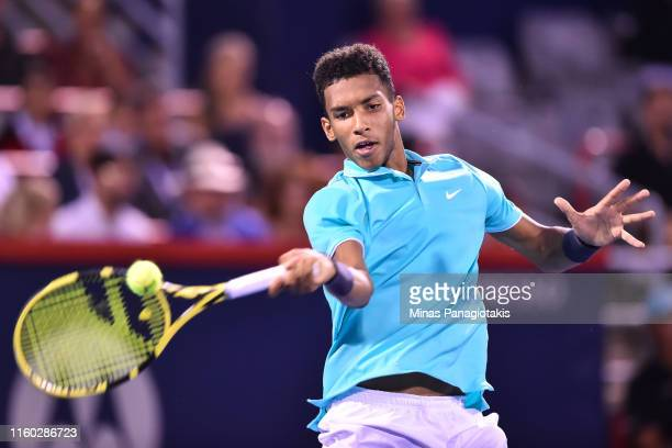 Felix AugerAliassime of Canada hits a return against Milos Raonic of Canada during day 6 of the Rogers Cup at IGA Stadium on August 7 2019 in...