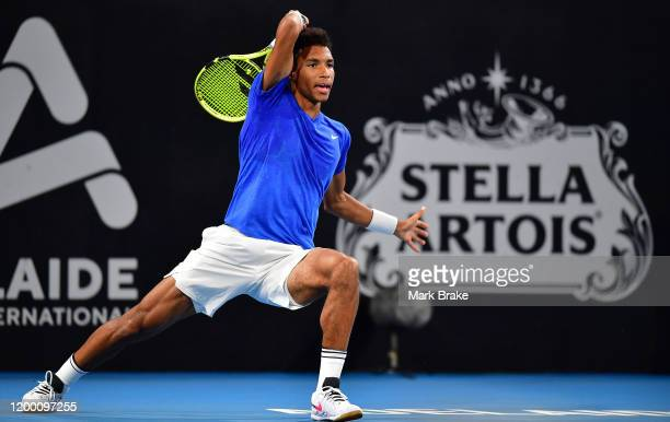 Felix AugerAliassime of Canada in action against Andrey Rublev of Russia during day six of the 2020 Adelaide International at Memorial Drive on...