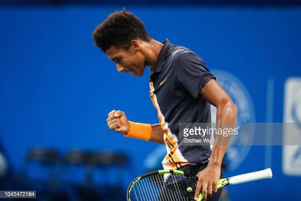 Felix AugerAliassime of Canada in action against Bernard Tomic of Australia during ATP World Tour Chengdu Open Quarter Finals at Sichuan...