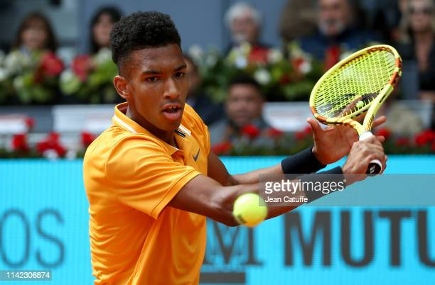Felix AugerAliassime of Canada in action against Rafael Nadal of Spain on day 5 of the Mutua Madrid Open at La Caja Magica on May 8 2019 in Madrid...