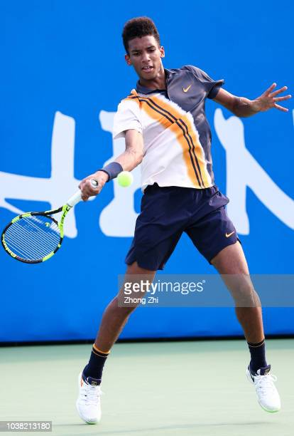 Felix AugerAliassime of Canada in action against Yusuke Takahashi of Japan during 2018 ATP Chengdu Open Singles Qualifying at Sichuan International...