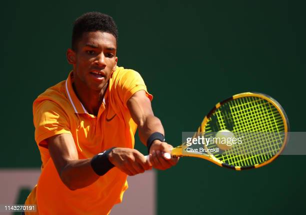 Felix AugerAliassime of Canada plays a backhand against Alexander Zverev of Germany in their second round match during day four of the Rolex...