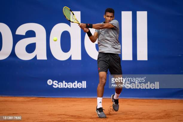 Felix Auger-Aliassime of Canada plays a backhand against Denis Shapovalov of Canada in their third round match during day four of the Barcelona Open...